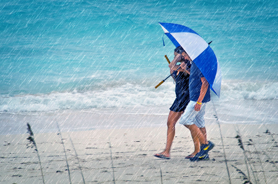 Beach Umbrella Rainstorm by Donald Scarinci